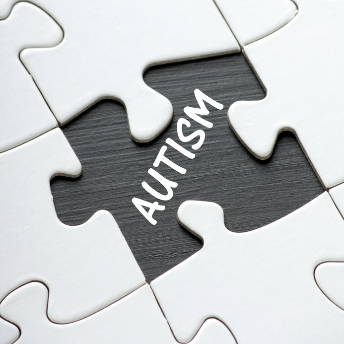 The word Autism revealed by a missing jigsaw puzzle piece