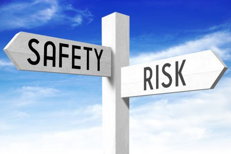 Risk, safety - wooden signpost
