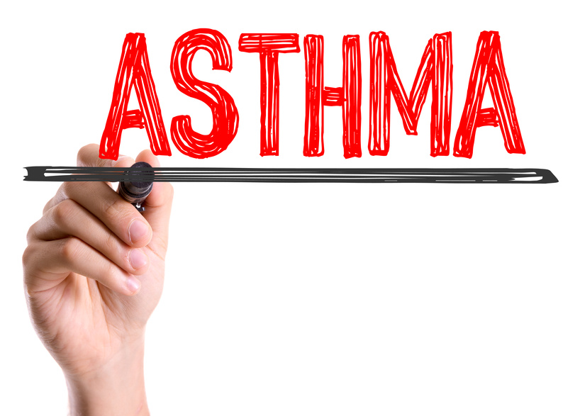 Hand with marker writing the word Asthma